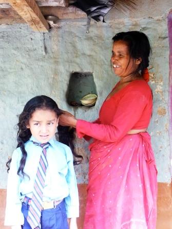 Nepali mom braids her daughter's hair before school