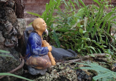a very little man at the pagoda