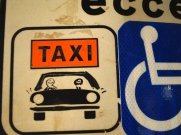 Taxi Passengers - I love that someone added passengers to this taxi sign!