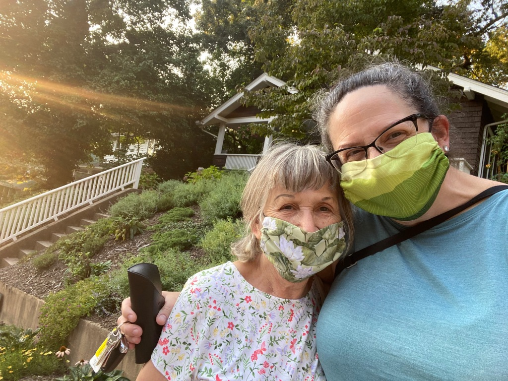Mom and I, masked up, outside my house, on her birthday.